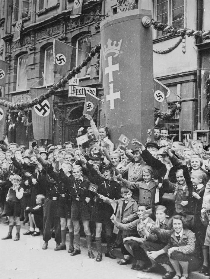 Compare 3 similarities of 1984 to Hitler and Nazism. What is the message to the people